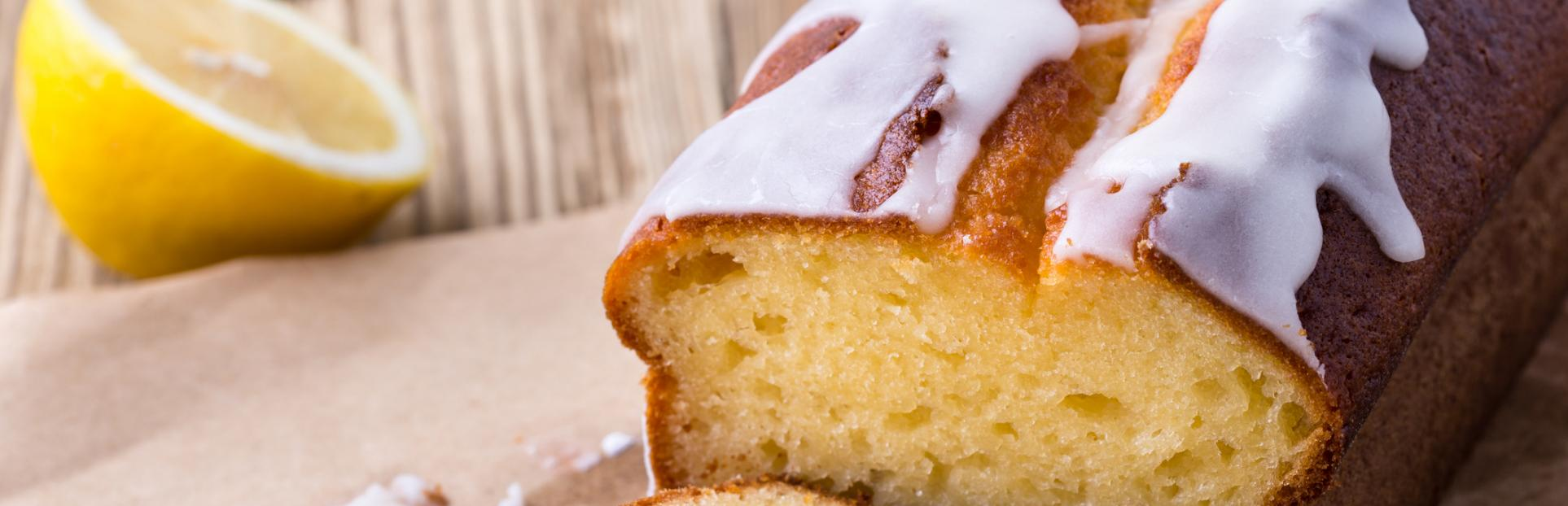 an image of a lemon loaf cake with white icing on top