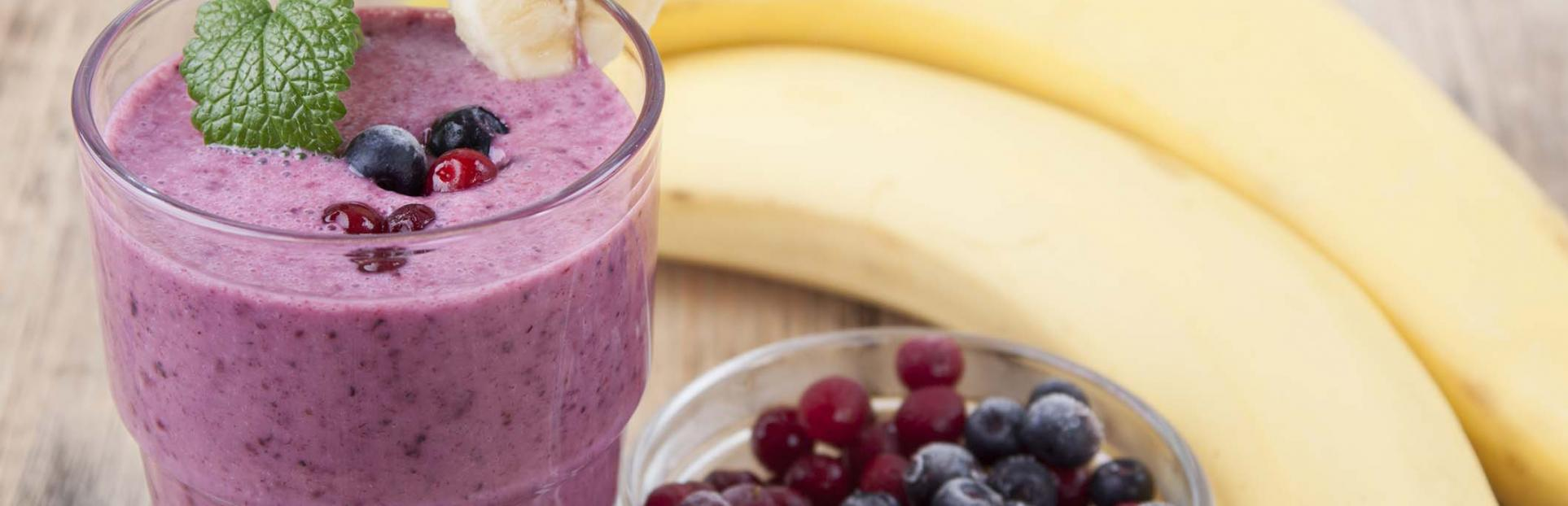 an image of a smoothie with bananas and berries