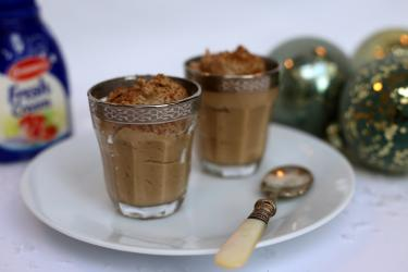 An image of two chocolate mousses in ramekins