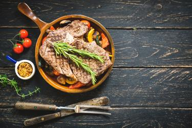 an image of braised pork chops in a pan