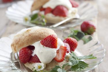 an image of shortcakes with strawberries and cream