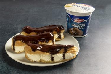 an image of chocolate eclaires and avonmore whipped cream